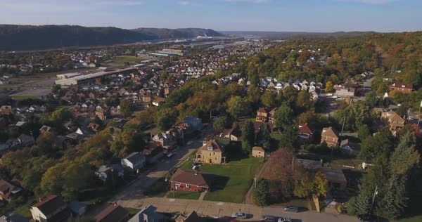 An aerial view above a small Western Pennsylvania town and residential neighborhood on an Autumn evening. Pittsburgh suburb.	 	 Royalty-free stock video