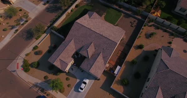 A high angle aerial establishing shot of a typical Arizona house. Phoenix suburb.  	 Royalty-free stock video