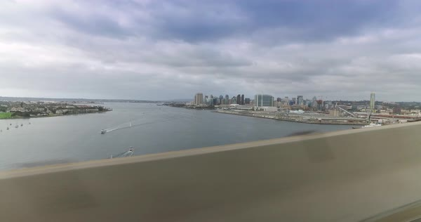 A side profile view of the skyline of San Diego while driving on the Coronado Bridge on an overcast Winter's day.  	 Royalty-free stock video