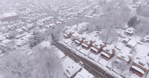 A slowly moving forward aerial snowing winter view of a typical Western Pennsylvania residential neighborhood.  Royalty-free stock video