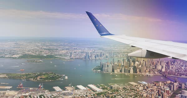 An aerial view of lower Manhattan as seen from the window of a landing jetliner. Royalty-free stock video