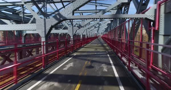 A unique forward perspective of a pedestrian or bicyclist traveling on the Williamsburg Bridge.  Royalty-free stock video