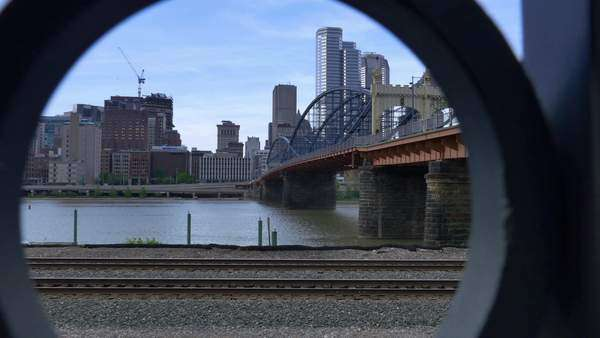 Looking through a fence at the Pittsburgh skyline. Royalty-free stock video