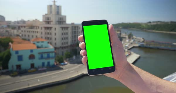 Holding a green screen smartphone in portrait mode high above the Havana, Cuba shoreline. Royalty-free stock video