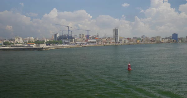 A high angle day wide dolly establishing shot of the shoreline of Havana, Cuba. The capitol dome can be seen in the distance. Royalty-free stock video
