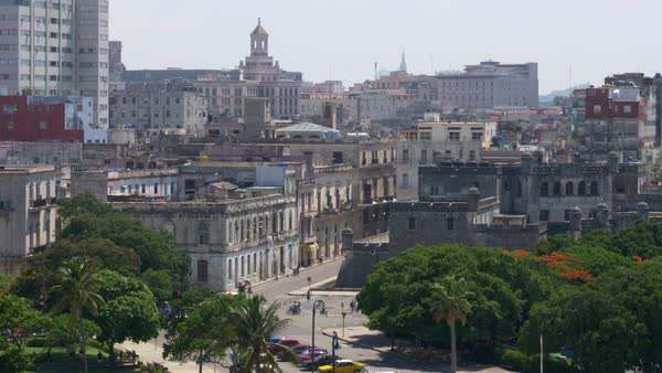 A slowly moving large format dolly establishing shot of old buildings in downtown Havana, Cuba. Royalty-free stock video