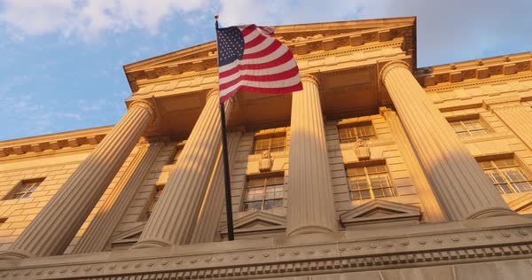 A low angle dusk establishing shot of a typical building in Washington, D.C.  Royalty-free stock video