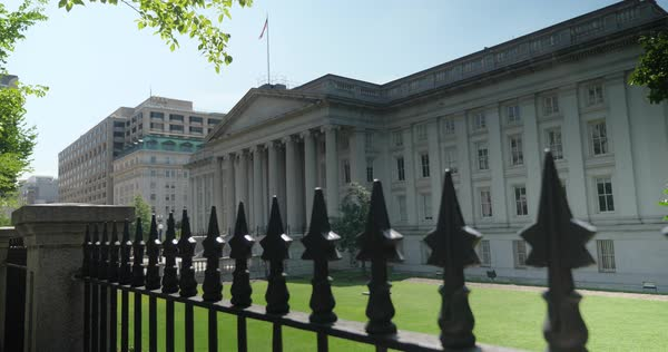 WASHINGTON, D.C. - Circa August, 2017 - A slow dollying establishing shot of the US Treasury Department on Pennsylvania Avenue in DC.   Royalty-free stock video