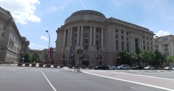 WASHINGTON, D.C. - Circa August, 2017 - A daytime driving shot of the Ronald Reagan Building and International Trade Center in downtown DC. Royalty-free stock video