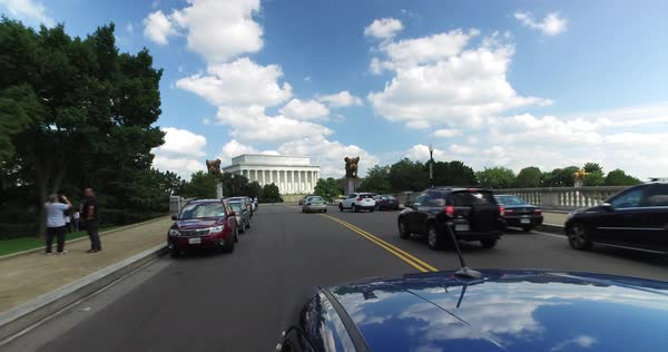 WASHINGTON, D.C. - Circa August, 2017 - A reverse driving perspective on the Arlington Memorial Bridge with the Lincoln Memorial in the distance.  Royalty-free stock video