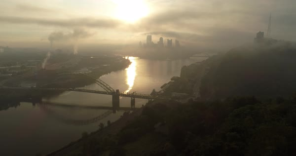 A cinematic forward aerial view of the Pittsburgh skyline on an early autumn foggy morning.   Royalty-free stock video