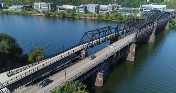 A slowly rising aerial view of the Hot Metal Bridge over the Monongahela River on Pittsburgh's South Side.   Royalty-free stock video