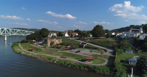 A dramatic reverse rising aerial establishing shot of the small western Pennsylvania town of Monaca on the Ohio River.  Royalty-free stock video