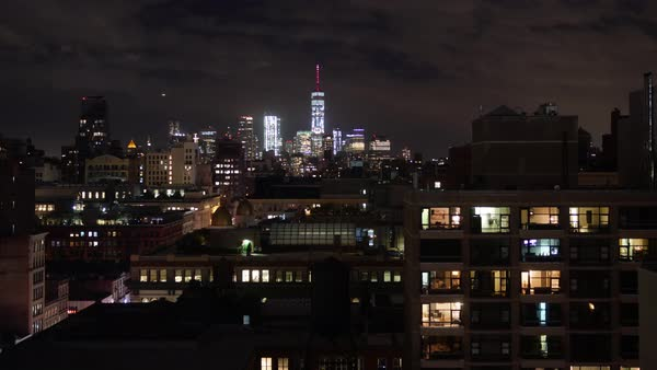 A dramatic nighttime timelapse view of lower Manhattan and the Freedom Tower.   Royalty-free stock video