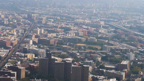 An aerial view of The Bronx on a late hazy morning.  Royalty-free stock video