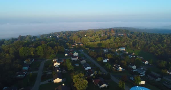 An early foggy autumn morning establishing shot over a typical New England residential neighborhood.   Royalty-free stock video