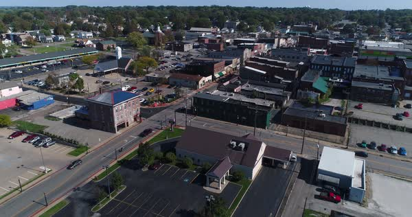 A daytime slow forward aerial establishing shot of the small town of Salem, Ohio's business district.   Royalty-free stock video
