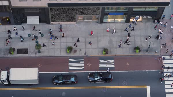 A high angle view of pedestrians and traffic on 5th Avenue in midtown Manhattan.   Royalty-free stock video