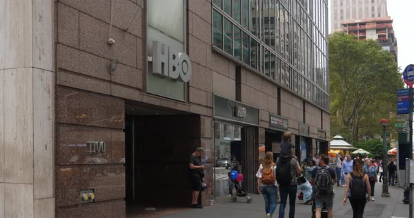 NEW YORK CITY - October, 2017 - Pedestrians and tourists walk past the HBO corporate offices and store in midtown Manhattan.   Royalty-free stock video