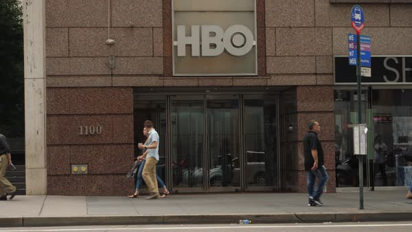 NEW YORK CITY - October, 2017 - Pedestrians and tourists walk past the HBO corporate office in midtown Manhattan. Royalty-free stock video