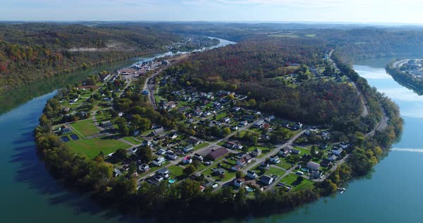 A high angle wide establishing shot of the small mill town of Newell, Pennsylvania nestled on a bend of the Monongahela River just south of Pittsburgh, PA.   Royalty-free stock video