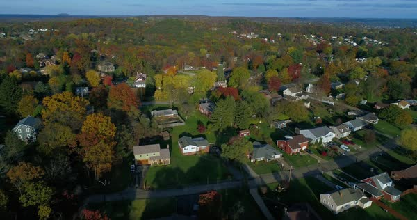 A reverse aerial flyover of a typical Western Pennsylvania residential neighborhood in the Fall Royalty-free stock video