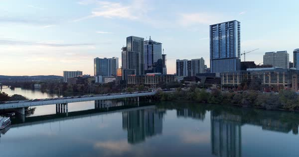A slow forward rising aerial evening establishing shot of the Austin, Texas skyline.   Royalty-free stock video