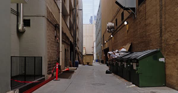A daytime overcast static background plate of an alley in a large city's downtown district. Royalty-free stock video