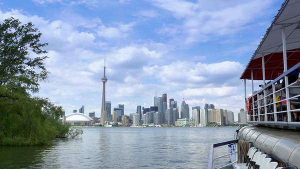 TORONTO, ONTARIO, CANADA - Circa June, 2014 - An establishing shot of Toronto, Canada as seen from a boat on Lake Ontario. Royalty-free stock video