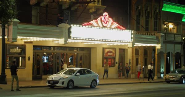 AUSTIN, TX - Circa December, 2017 - A nighttime establishing shot of the marquee outside of the Paramount Theater on Congress Avenue in Austin, Texas.   Royalty-free stock video