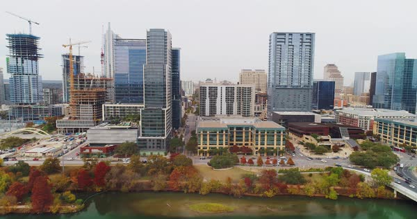 A daytime overcast aerial profile view of the Austin, Texas skyline with the Colorado River in the foreground.   Royalty-free stock video
