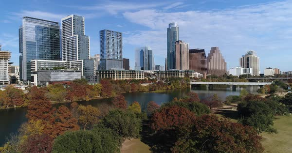 A slow pushing forward aerial establishing shot view (DX) of the Austin, Texas skyline on a sunny late Autumn day.   Royalty-free stock video