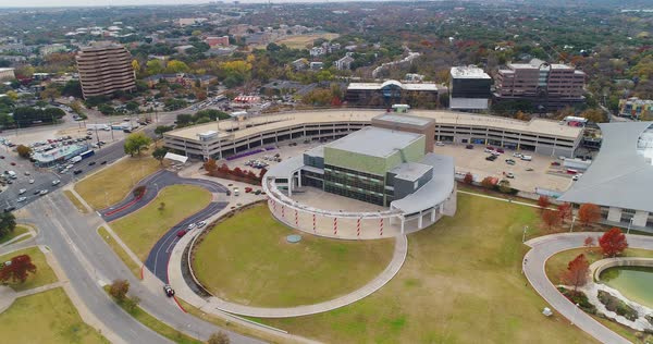 AUSTIN, TX - Circa December, 2017 - An aerial establishing shot of The Long Center for the Performing Arts in Austin, Texas.   Royalty-free stock video