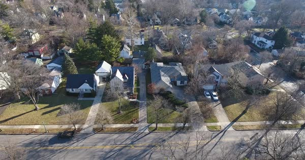 A daytime Winter aerial establishing shot of a typical residential neighborhood in central Ohio. Homes and traffic.   Royalty-free stock video