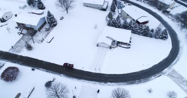 A high angle aerial view of a snow covered typical Pennsylvania neighborhood. Pittsburgh suburb.   Royalty-free stock video
