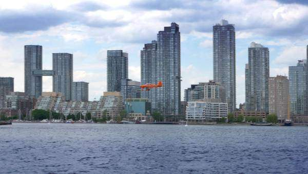 TORONTO, ONTARIO, CANADA - Circa June, 2014 - An airplane comes in for a landing at the airport on Toronto Islands. Royalty-free stock video