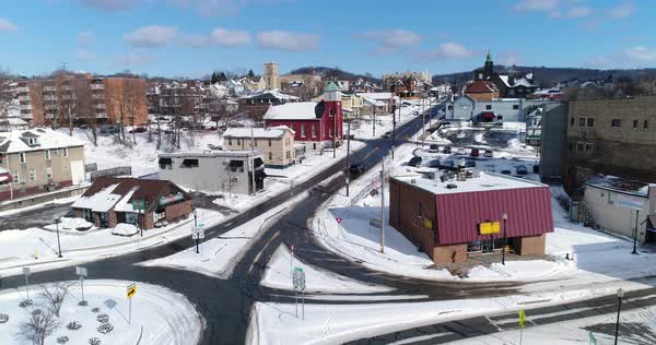 A rising winter aerial shot of traffic patterns in the downtown business district of Rochester, PA, a Pittsburgh suburb.   Royalty-free stock video