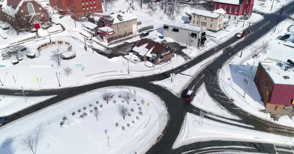 A slow forward winter tilt up aerial shot of traffic patterns in the business district of downtown Rochester, PA, a Pittsburgh suburb.   Royalty-free stock video