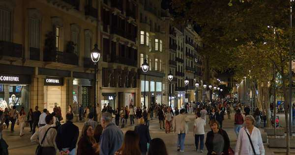 BARCELONA, CATALONIA, SPAIN - Circa October, 2014 - People walk the popular and crowded streets and sidewalks of Barcelona's Gothic District at night. Royalty-free stock video