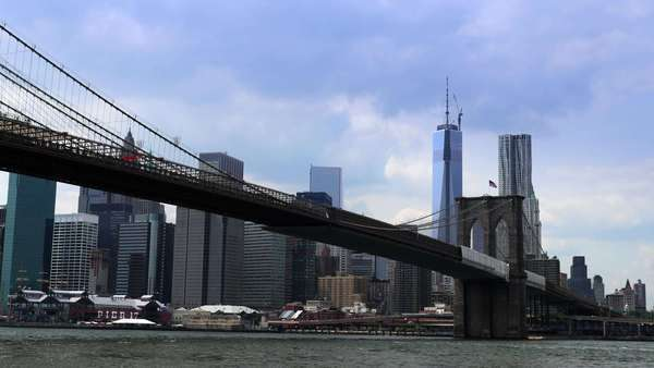 A dramatic timelapse of the New York City skyline behind the Brooklyn Bridge. Royalty-free stock video