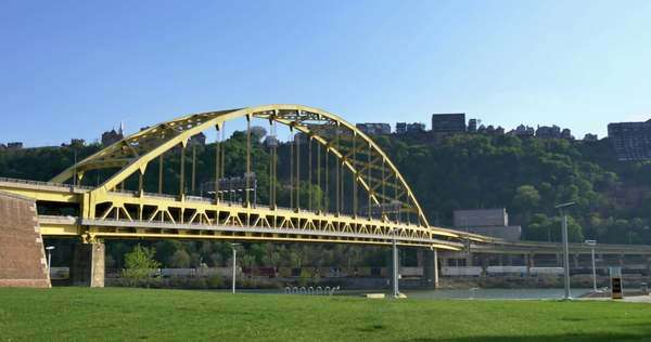 An establishing shot of the Fort Pitt Bridge over the Monongahela River in Pittsburgh, PA. Royalty-free stock video