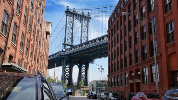 A time lapse establishing shot of the Manhattan Bridge as seen from Washington Street in Brooklyn. Royalty-free stock video