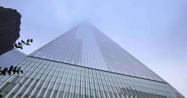 NEW YORK CITY - Circa June, 2015 - A timelapse view looking straight up at the Freedom Tower on a cloudy day. Royalty-free stock video