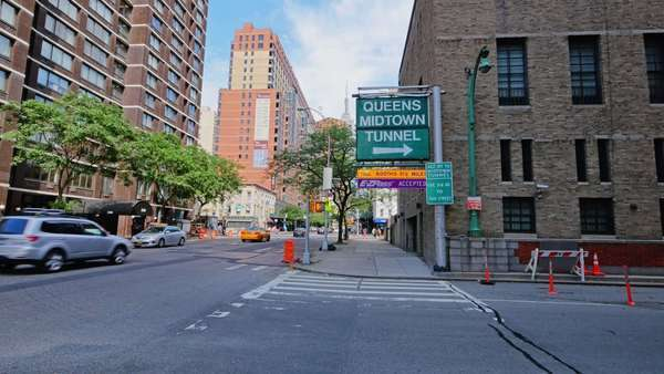 NEW YORK CITY - June, 2015 - An establishing shot of the entrance to the Queens Midtown Tunnel. Royalty-free stock video