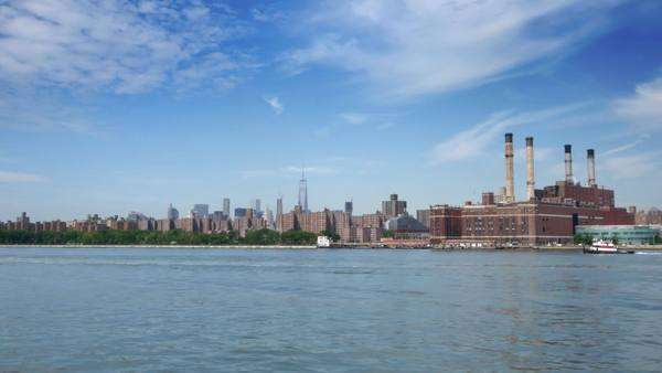 NEW YORK CITY, Circa June, 2015 - A daytime view of the skyline of Manhattan as seen from the East River Ferry. Royalty-free stock video