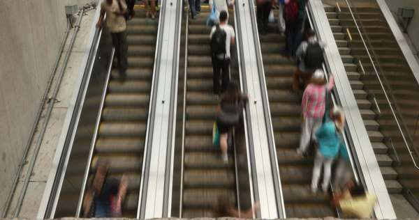 A fast motion timelapse of commuters on the Foggy Bottom escalators in Washington, D.C. Royalty-free stock video