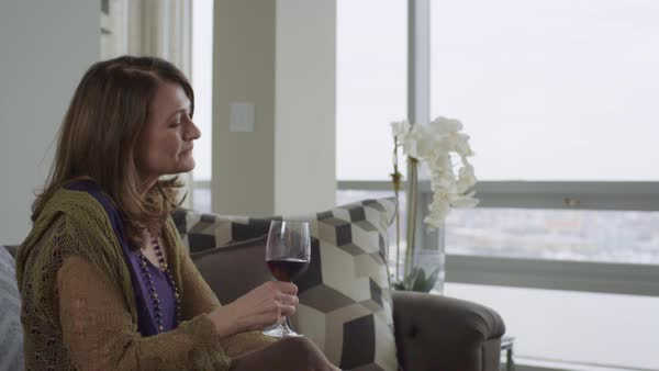 Medium shot of a woman drinking red wine Royalty-free stock video