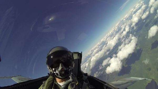 A pilot or passenger is shown flying in a F18 fighter plane, the clouds and ground whizzing by as they do maneuvers flipping the plane in a complete barrel roll. Royalty-free stock video