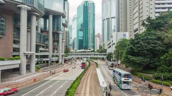 Hong Kong, China - Jun 8, 2015: timelapse video of a busy road in the central business district of Hong Kong Royalty-free stock video
