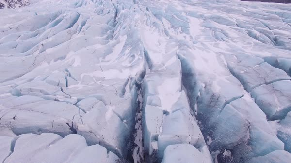 Aerial shot of glacier in Iceland, pan up. Rights-managed stock video